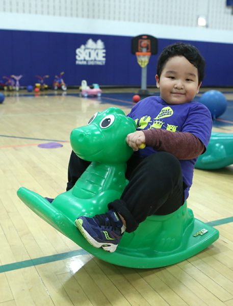 Child on dinosaur at Weber gym